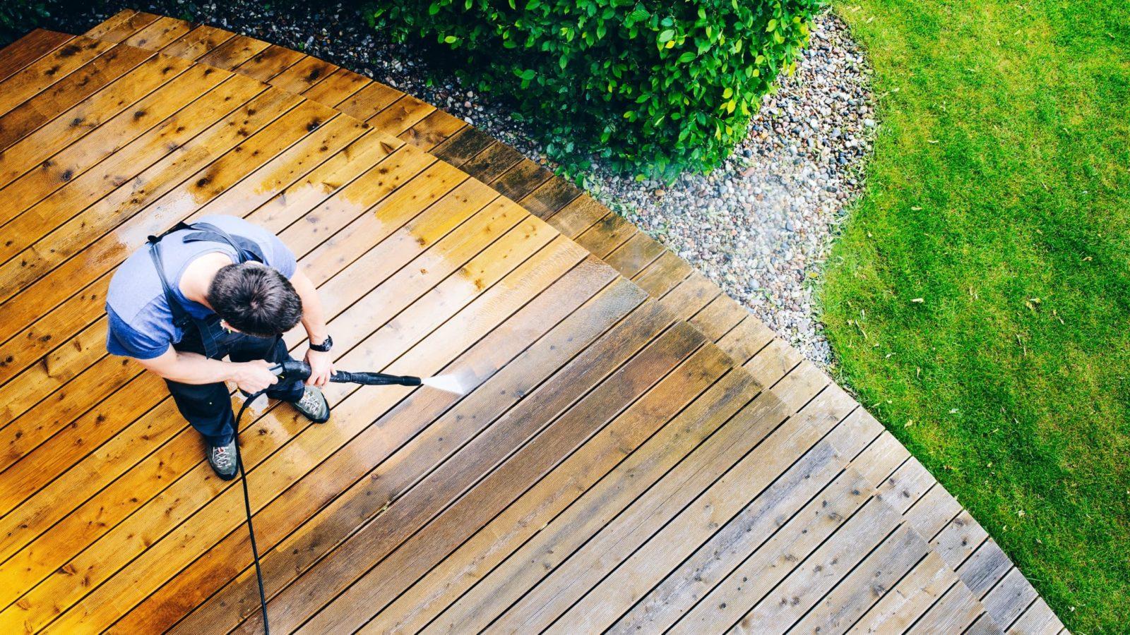 Man cleaning garden decking