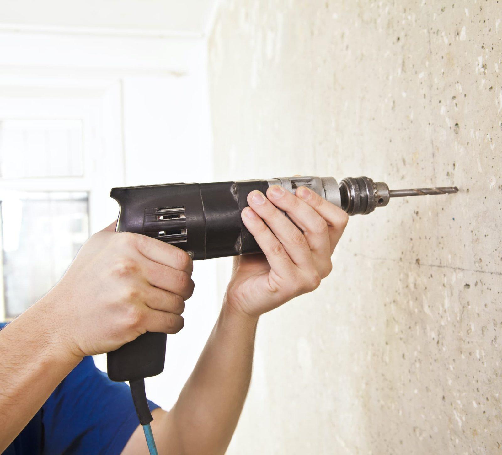 drilling into brick