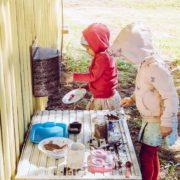 kids playing in mud kitchen