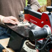 man using scroll saw for woodworking