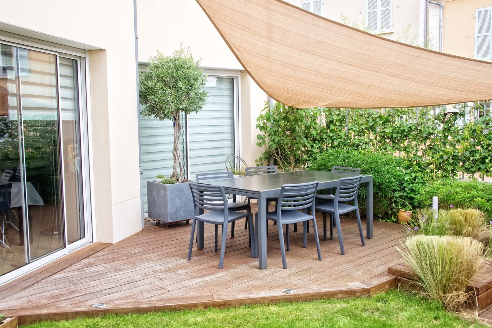 garden with decking, furniture and parasol