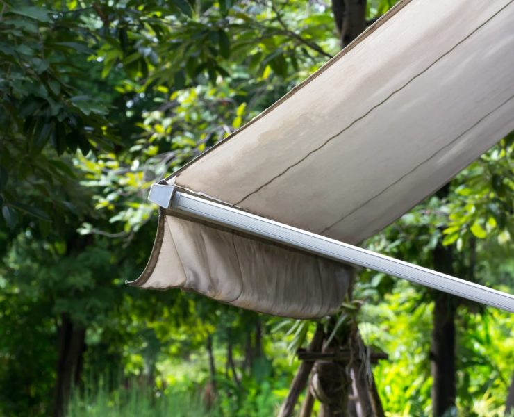 garden awning with trees in background