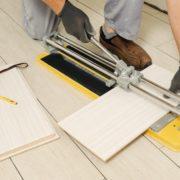 man cutting ceramic tiles