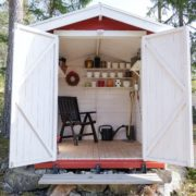 garden shed with doors wide open and seating / shelves inside