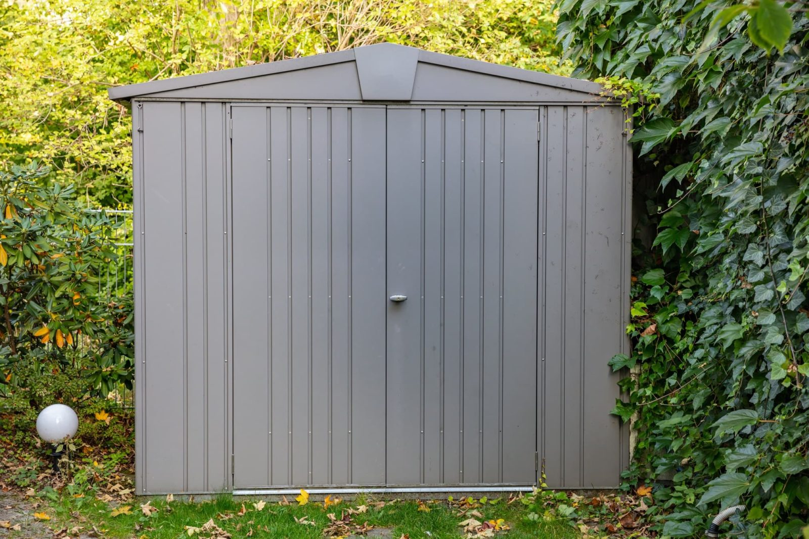 plastic shed in corner of garden