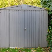 plastic shed in corner of garden
