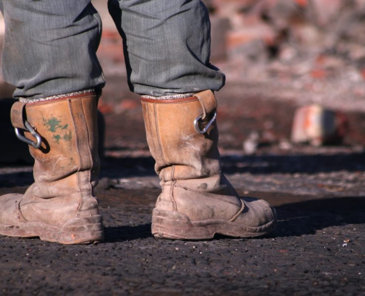 worman on site in rigger boots