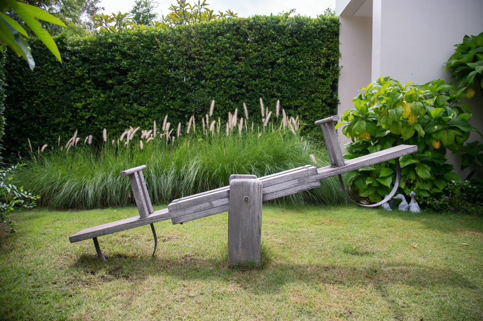 wooden seesaw in garden