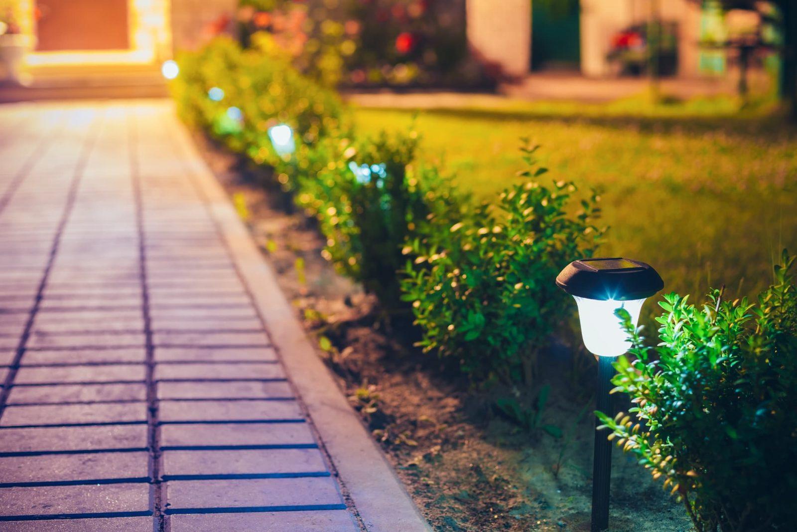 solar garden lights arranged along a driveway