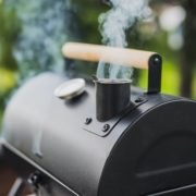smoke pouring from bbq smoker in garden