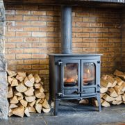 wood burning stove with logs either side