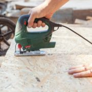 jigsaw being used on timber boards