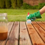 oil being spread over decking surface