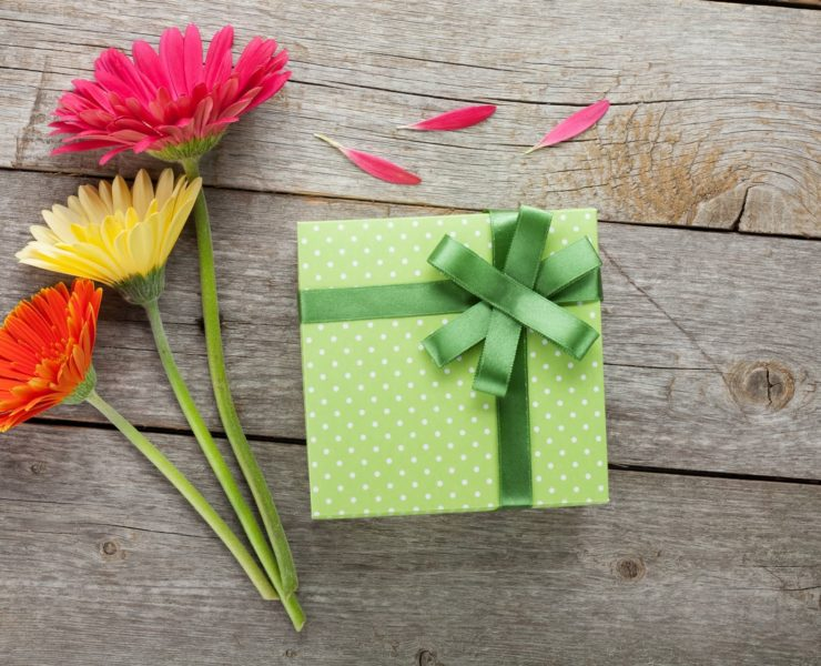green gift box with flowers