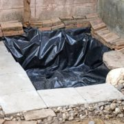 man made garden pond with black lining