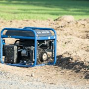 blue and black portable generator on garden soil