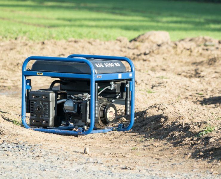blue and black portable generator on garden soil