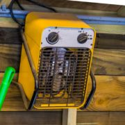 yellow heater hung up in a shed