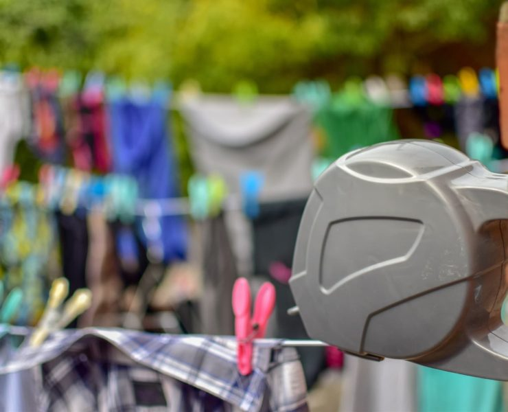 grey retractable washing line with clothes hung in background