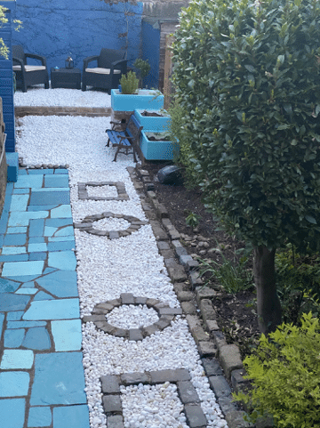 transformed garden with tiling and neatly arranged gravel