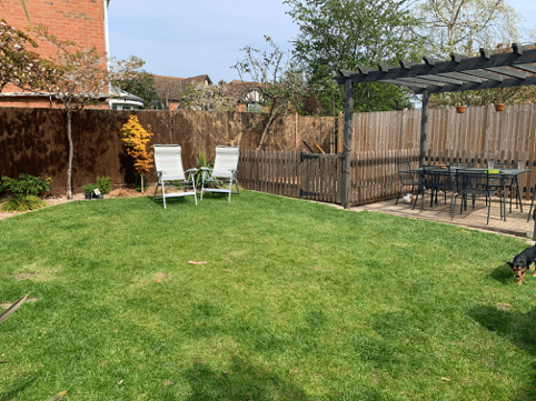 garden lawn with deck chairs and pergola seated area