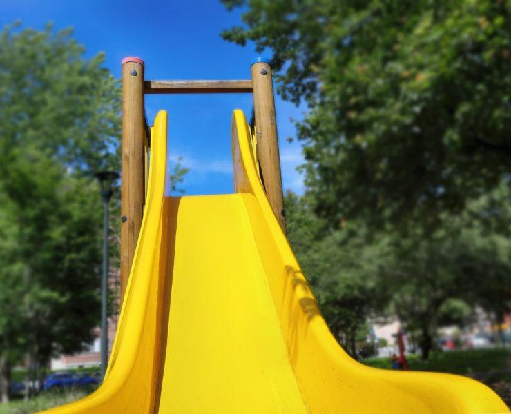 bottom of a yellow kids slide
