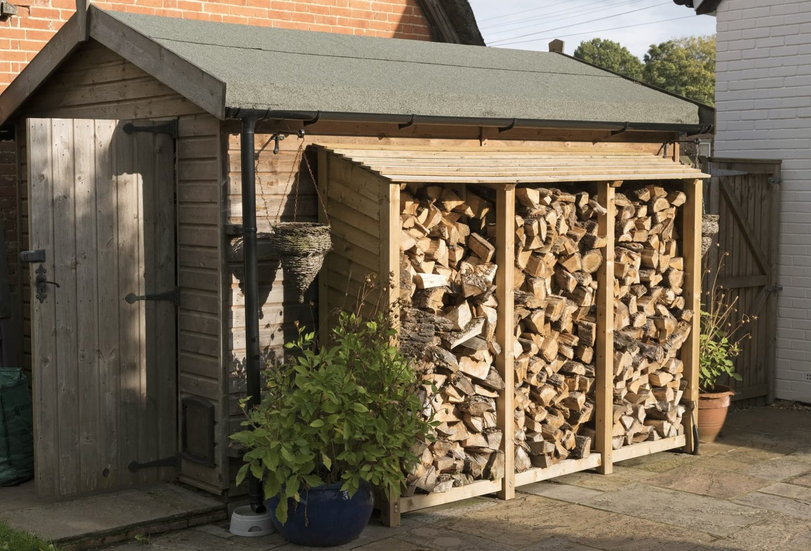 log store on the outside of a garden shed