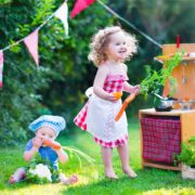 kids playing with garden kitchen toys