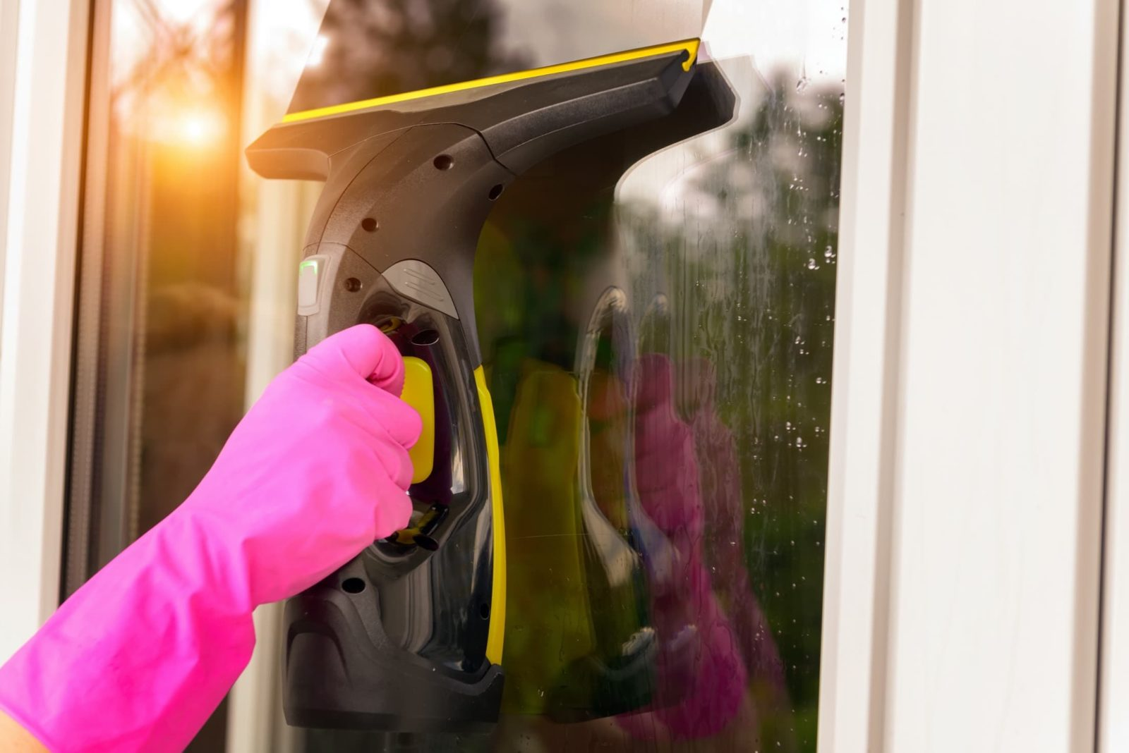 window vacuum in use with pink rubber gloves