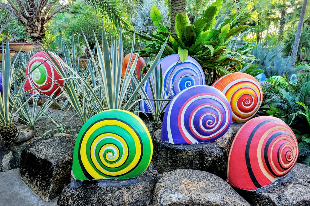 colourful snail sculptures in a garden