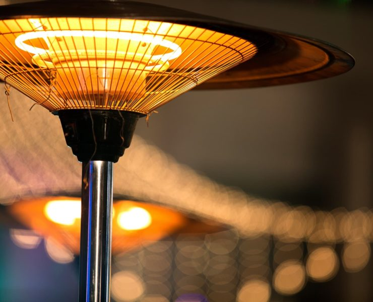 an electric patio heater looking very warm in a garden
