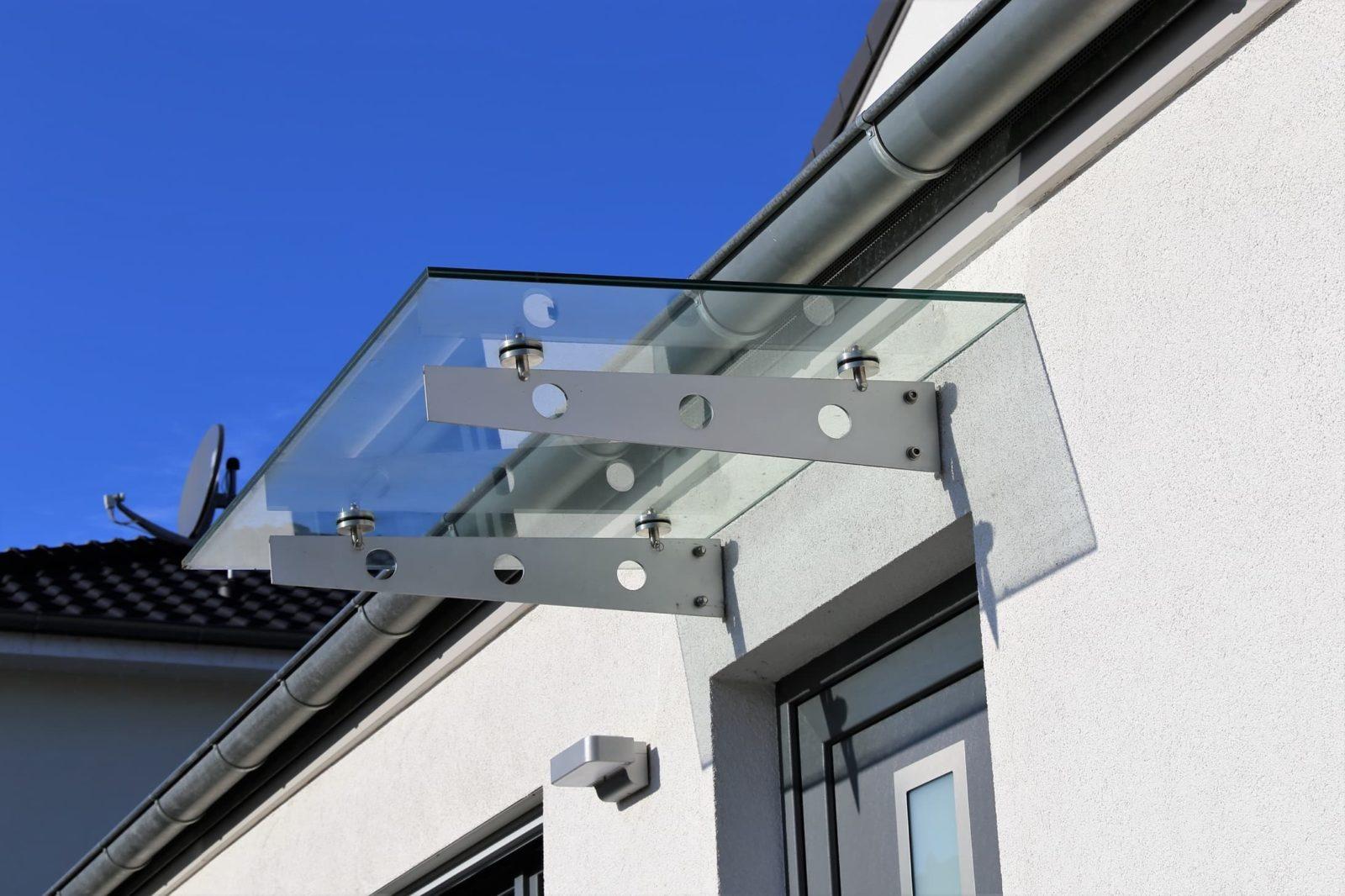 glass canopy over grey door