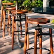 black bar tables with multiple wooden stools