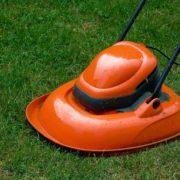 orange hover mower on a garden lawn