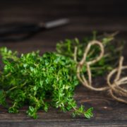 thyme bound with twine on a wooden table