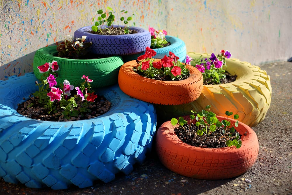 painted tyres used as planters
