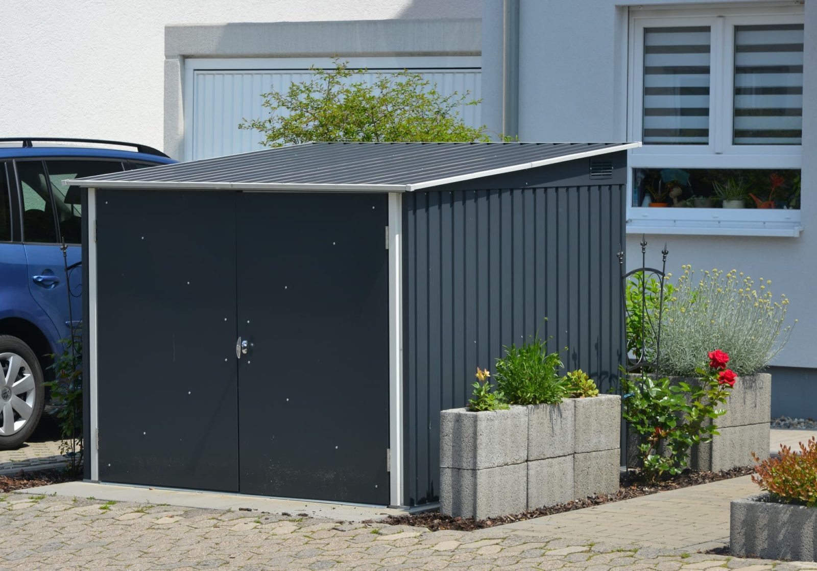a blue outdoor storage shed