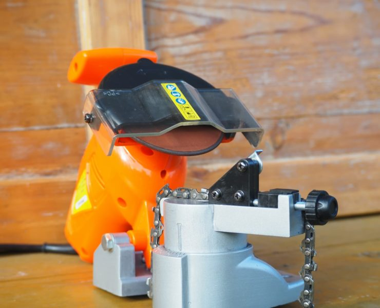 an orange electric chainsaw sharpener