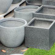 various stone planters in a garden centre