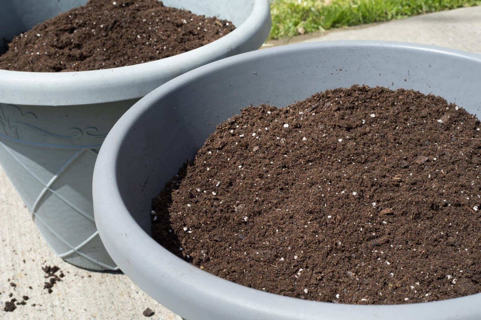 potting soil in large grey planters