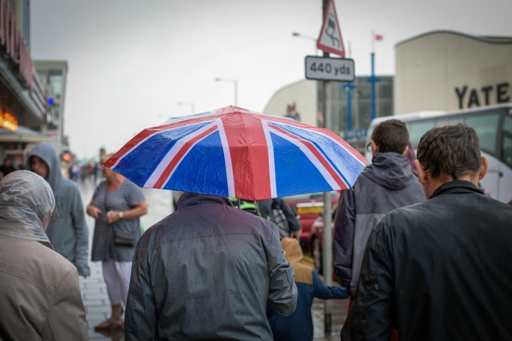 man under an umbrella in Britain