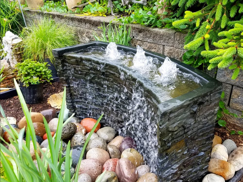 a bubbling garden water fountain with cascading wall