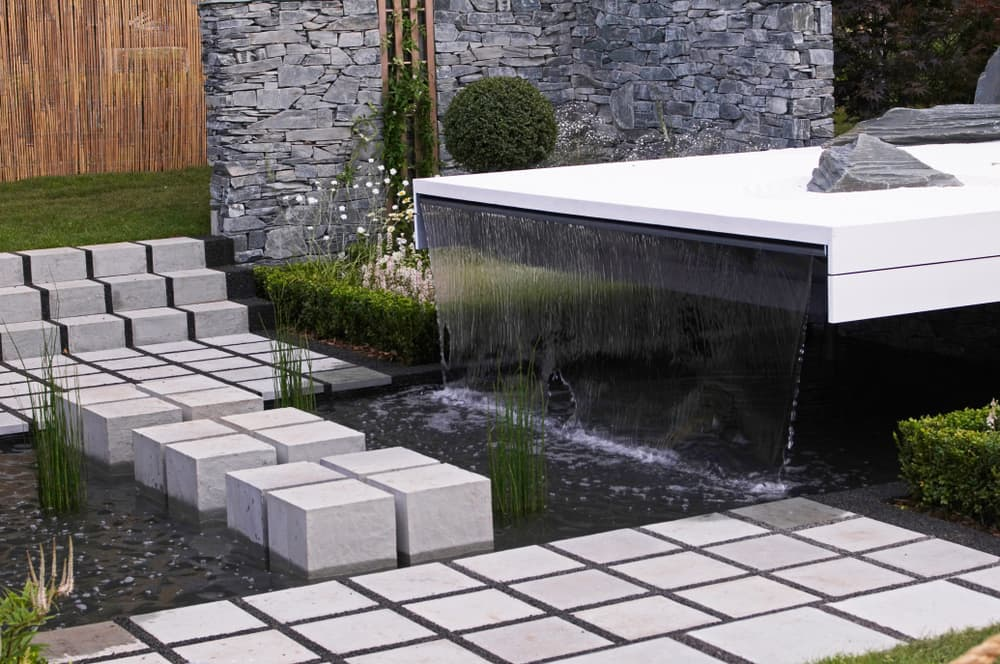 stepping stones over a garden water feature
