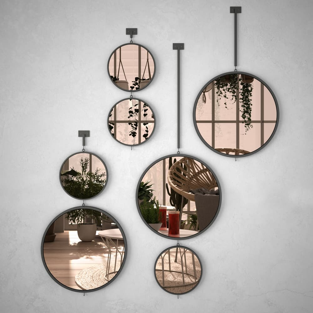 mirrors on a stone wall
