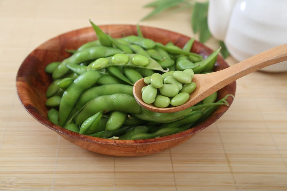 freshly boiled soybeans on a wooden spoon