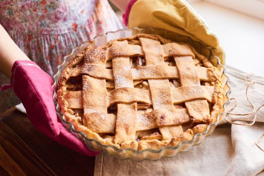 woman holding freshly baked apple pie