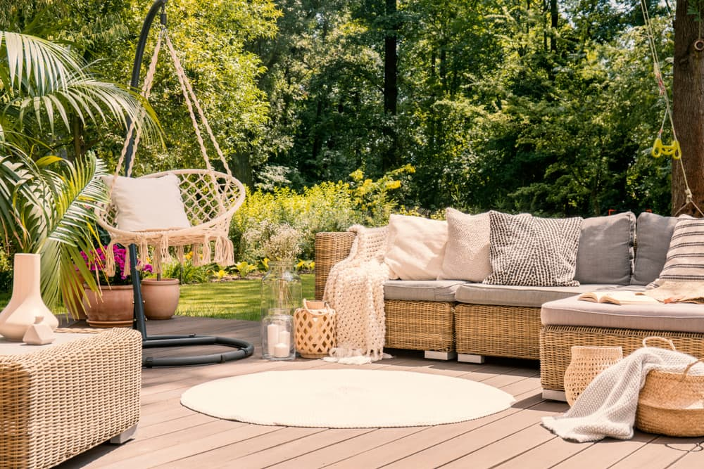 garden sofas and a hanging chair on outdoor decking