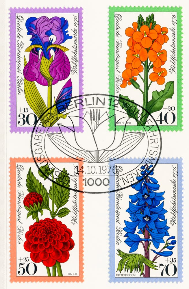 an old Berlin stamp set with illustrated wallflowers, iris, dahlia and delphinium
