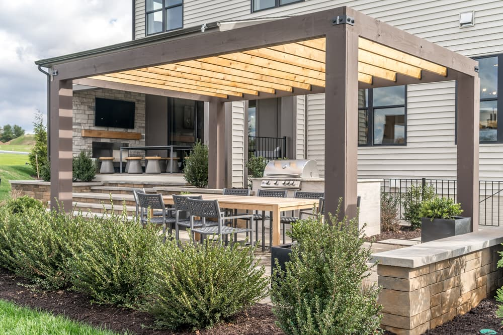 a canopy covering a BBQ and patio furniture