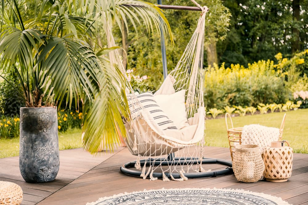 a hammock and a plant on a garden deck